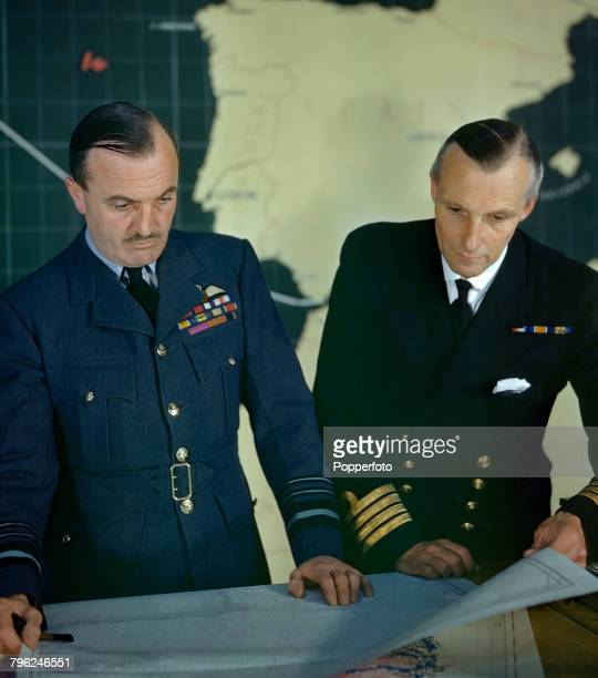 Royal Air Force Air Marshal John Slessor Chief of Coastal Command pictured left with Naval Liason Officer Captain Dudley Vivian PeytonWard of the...