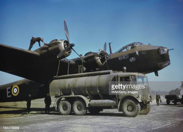 Royal Air Force Bomber Command, 1942-1945, Groundcrew refuelling Short Stirling Mark I, N1601 'E', of No.1651 Heavy Conversion Unit, from an AEC 6x6...