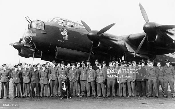 Royal Air Force Bomber Command 19421945 Members of No 106 Squadron RAF gather in front of Avro Lancaster B Mark I ED593 'ZNY' 'Admiral Prune II' the...