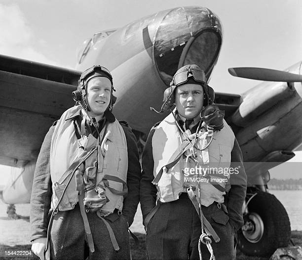 Royal Air Force Bomber Command 19421945 Wing Commander R W Reynolds pilot and Officer Commanding No 139 Squadron RAF and his navigator Flight...