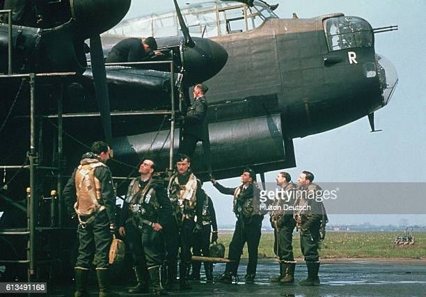 Royal Air Force bomber command crew with an Avro Lancaster bomber.