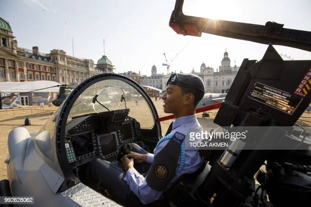 A Royal Air Force cadet is given a demonstration in the cockpit of a fullscale replica of Eurofighter Typhoon during the RAF100 Aircraft Tour at...