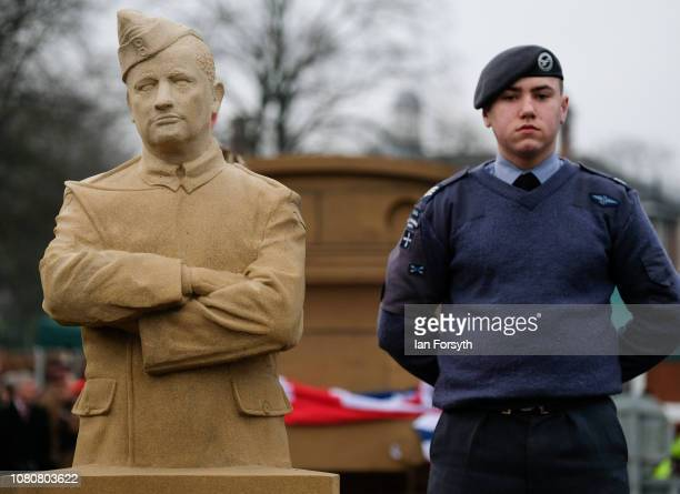 Royal Air Force cadet stands next to a sculpture of a member of the Royal Flying Corps during an unveiling by former Royal Engineer and Dunkirk...