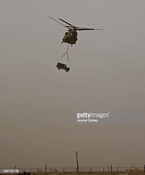 Royal Air Force CH47 Chinook helicopter swoops into the British military headquarters in Lashkar Gah the capital of Helmand province in southern...