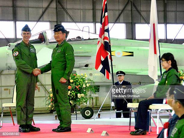 Royal Air Force Chief of the Air Staff Stephen Hillier and Japan Air SelfDefense Force Chief of Staff Yoshiyuki Sugiyama shake hands while Japanese...