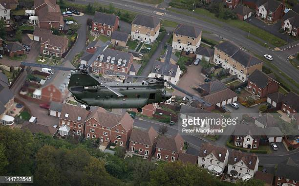 Royal Air Force Chinook helicopter flies over housing during a rehearsal for a Diamond Jubilee flypast on May 18 2012 near Alton England The armed...