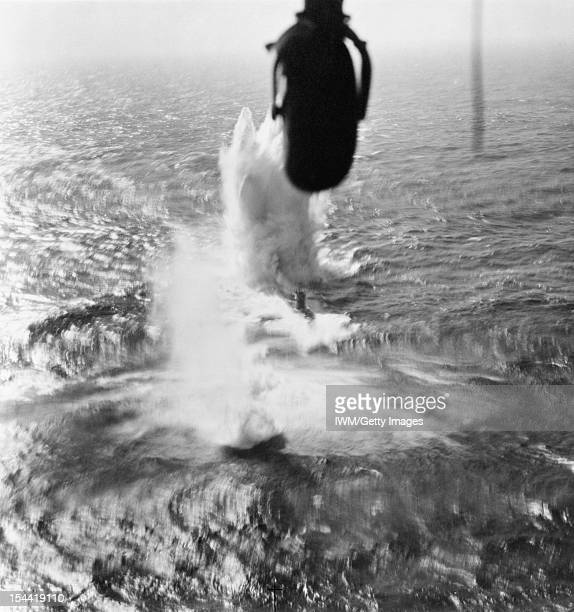 Royal Air Force Coastal Command, 1939-1945, Mirror camera oblique aerial photograph showing depth charges straddling the German type VIIC submarine...