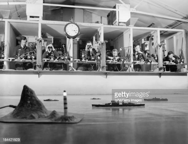 Royal Air Force Coastal Command 19391945 Pupil pilots identifying vessels at sea using models on the Tactical Floor in No 3 School of General...