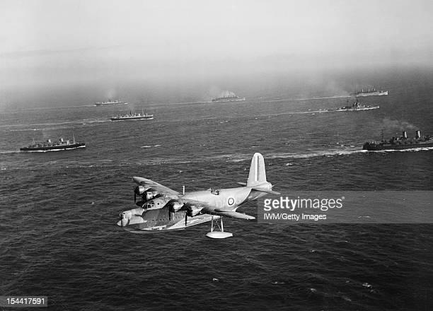 Royal Air Force Coastal Command 19391945 Sunderland Mark I L2163 'DAG' of No 210 Squadron RAF based at Oban Argyll flys past Canadian Troop Convoy 6...