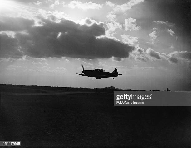 Royal Air Force Fighter Command, 1939-1945, Boulton Paul Defiant Mark I night-fighter of No. 264 Squadron RAF, silhouetted against the clouds during...
