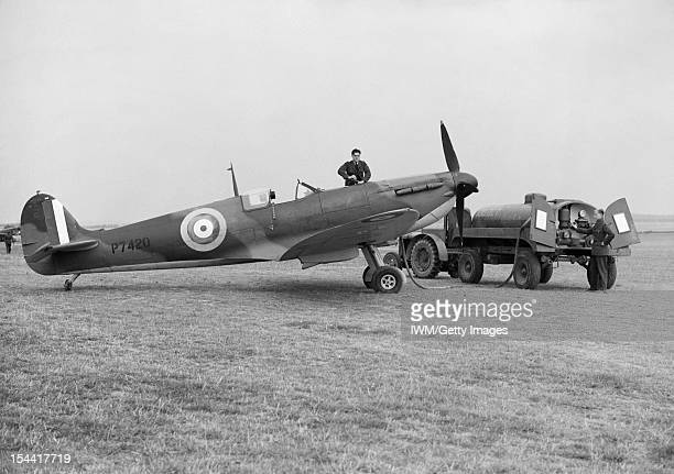 Royal Air Force Fighter Command 19391945 Groundcrew refuelling Supermarine Spitfire Mark IIA P7420 of No 19 Squadron RAF from a tractordrawn petrol...