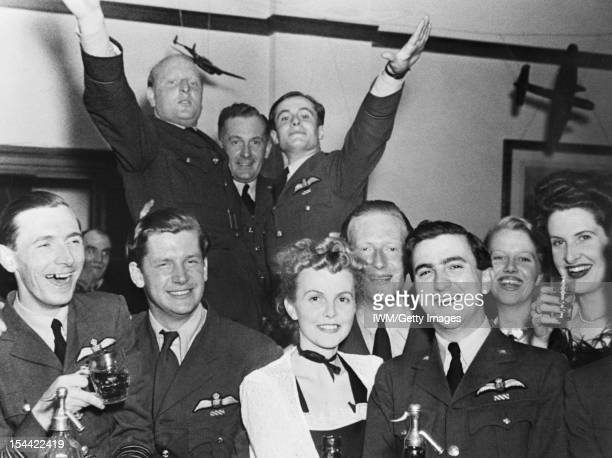 Royal Air Force Fighter Command, 1939-1945, Officers and guests celebrating the first anniversary of the arrival of No 92 Squadron RAF at Biggin...