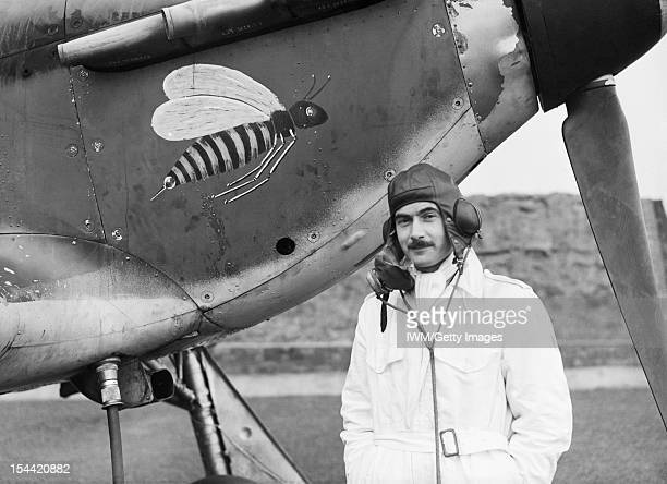 Royal Air Force Fighter Command 19391945 Pilot Officer A V 'Taffy' Clowes of No 1 Squadron RAF standing by the nose of his Hawker Hurricane Mark I...