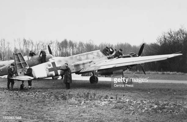 Royal Air Force groundcrew technicians of No1426 Flight RAF and known as the Rafwaffe examine a captured Nazi Luftwaffe Henschel Hs 129B twin engined...
