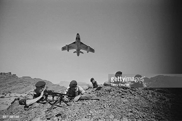 Royal Air Force Hawker Hunters flying above troops of the 45 Commando Royal Marines in the Radfan region during the Aden Emergency Yemen 9th March...