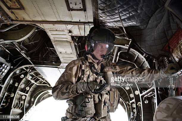 Royal Air Force loadmaster is seen on board of the MERT CH-47 Chinook helicopter as the members of the MERT fly out of Camp Bastion to rescue a...