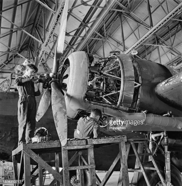 Royal Air Force maintenance crew menbers from RAF Bomber Command repair the damaged Bristol Pegasus XVIII radial piston aero engine of a twin engined...
