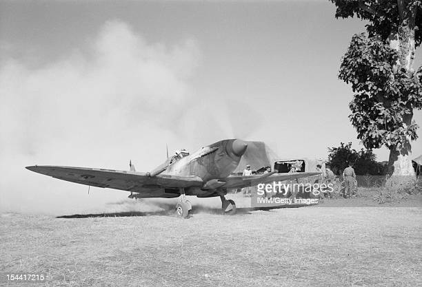 Royal Air Force Operations In The Far East 19411945 A Supermarine Spitfire Mark VIII of No 155 Squadron RAF creates a cloud of dust as the pilot...