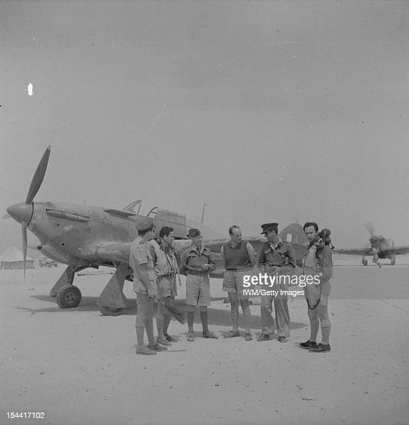 Operations In The Middle East And North Africa 19391943 Pilots of No 335 Squadron RAF in front of a Hawker Hurricane Mark I at LG 20/Qotafiyah I west...