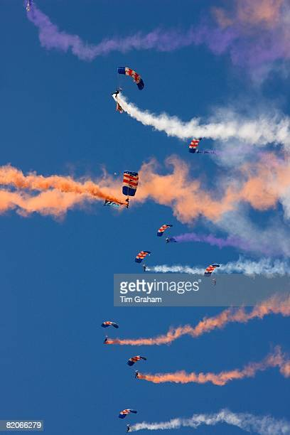 Royal Air Force parachute display with coloured smoke trails Norfolk United Kingdom
