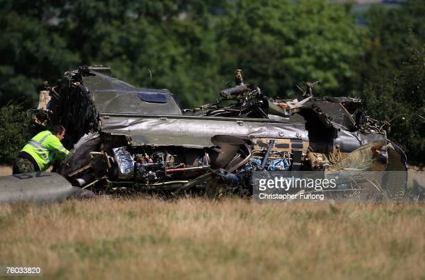 Royal Air Force personnel inspect the wreckage of a Puma helicopter which crashed the previous evening on Catterick Garrison training area on August...