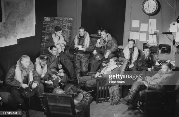 Royal Air Force fighter pilots stand by for their instructions in a ready room at a RAF Fighter Command station in England during The Battle of...