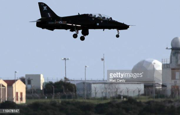 Royal Air Force Red Arrow comes into land after completing a training exercise at the British RAF Akrotiri airbase on March 19 2011 in Cyprus Defence...