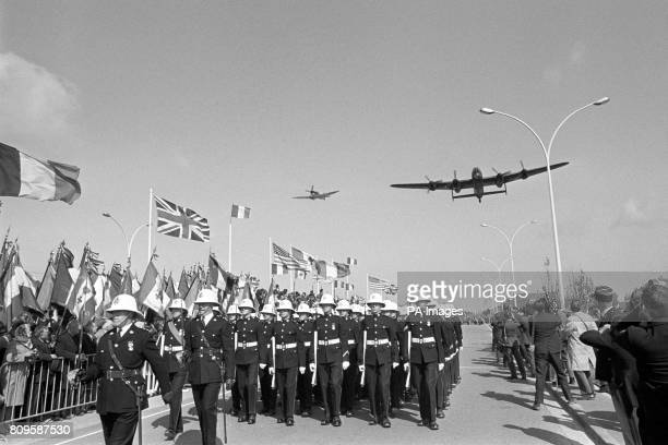 A Royal Air Force Spitfire fighter and Lancaster bomber fly over the 25th Anniversary ceremony of the Normandy Landings of World War Two in France...