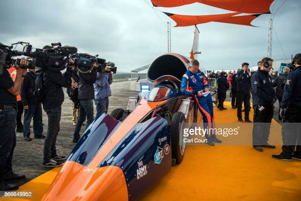 Royal Air Force Wing Commander Andy Green leans against the Bloodhound supersonic car as it is prepared for a test run at the airport on October 26...