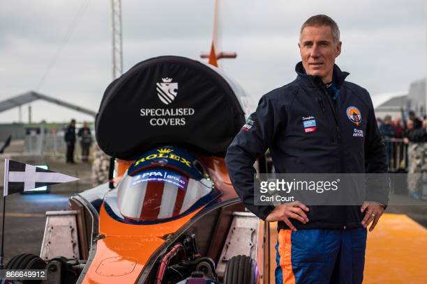 Royal Air Force Wing Commander Andy Green poses for a photograph next to the Bloodhound supersonic car as it is prepared for a test run at the...