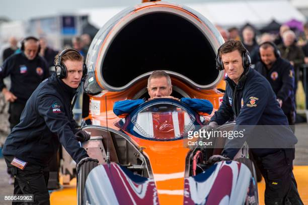 Royal Air Force Wing Commander Andy Green sits in the Bloodhound supersonic car as it is prepared for a test run at the airport on October 26 2017 in...