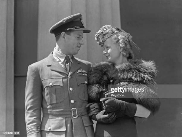 Royal Air Force Wing Commander Guy Gibson and his wife Eve after his investiture at Buckingham Palace London 22nd June 1943