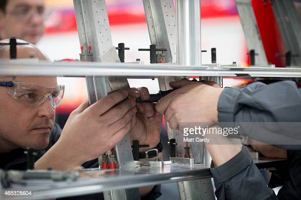 Royal Airforce engineers work on a tail fin of the Bloodhound SSC vehicle currently taking shape at its design centre in Avonmouth on March 5 2015 in...