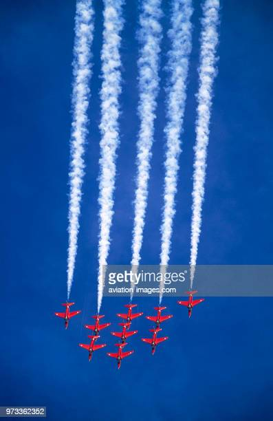 Royal AirForce RAF Red Arrows BAE Hawks with white smoke in the flyingdisplay at the 2001 Mildenhall Air Fete