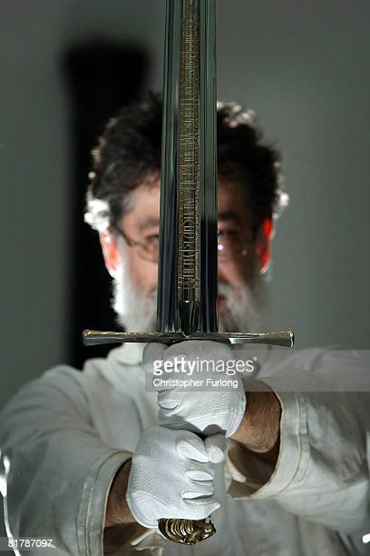 Royal Armouries Curator of European Edged Weapons Bob WoosnamSavage poses with 'Peter's sword from 'The Chronicles of Narnia The Lion The Witch and...