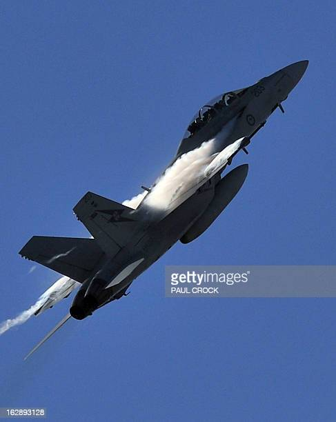 A Royal Australian Air Force FA18 Super Hornet performs a flying demonstration at the first public day at the Australian International Airshow in...