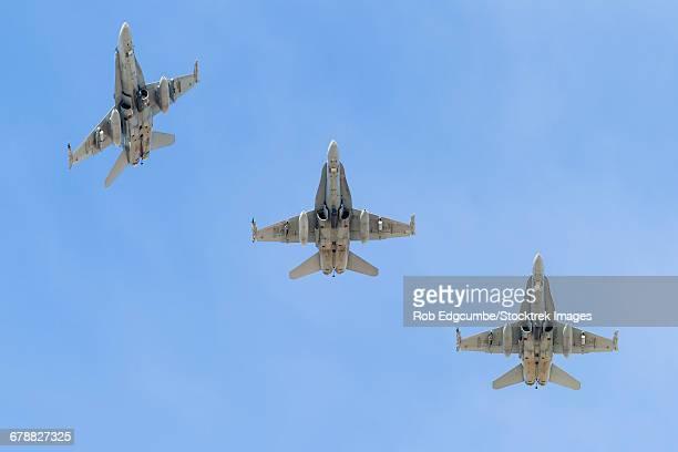 royal australian air force f/a-18a hornets break overhead. - オーストラリア空軍 ストックフォトと画像