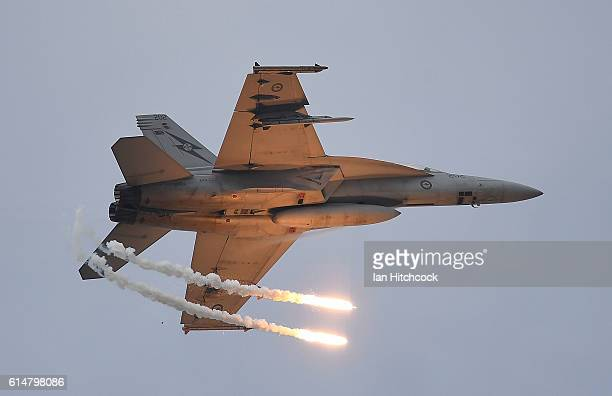 Royal Australian Air Force F/A18F Super Hornet drops two flares as it performs during the T150 Defence Force Air Show on October 15 2016 in...