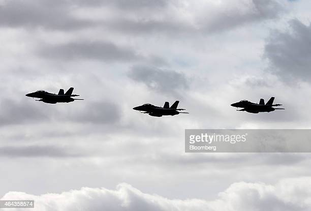 Royal Australian Air Force F/A18F Super Hornet fighter jets manufactured by Boeing Co fly in formation during the Australian International Airshow...