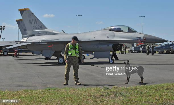 A Royal Australian Air Force security guard walks in front of an F16 Fighting Falcon in the US Fighter compound during the Australian International...