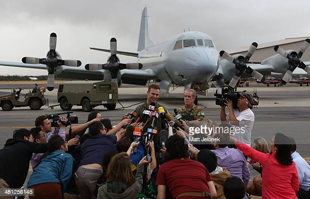 Royal Australian Airforce Flight Lieutenant Russell Adams speaks to media at Pearce Airbase on March 29 2014 in Perth Australia Five search aircraft...