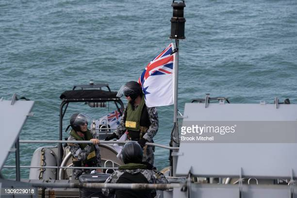Royal Australian Navy officers are seen aboard the the Armidale Class Patrol Boat the HMAS Wollongong in waters between Papua New Guinea and the...
