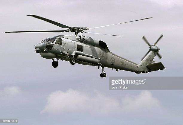 Royal Australian Navy Sea Hawk helicopter hovers during a demonstration January 26 2006 in Sydney Australia
