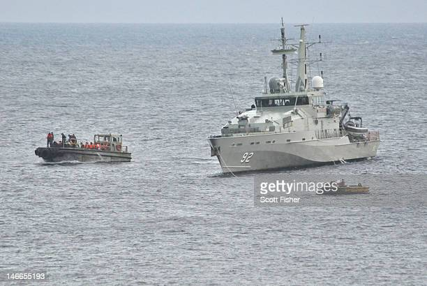 Royal Australian Navy Ship takes part in a rescue effort of suspected asylum seekers after their boat capsized on June 22 2012 on Christmas Island...