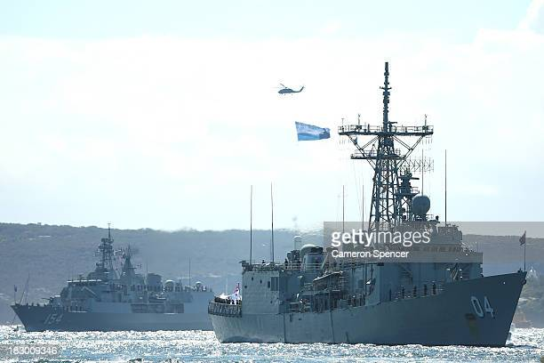 Royal Australian Navy warships HMAS Darwin and HMAS Parramatta enter Sydney Harbour on October 4 2013 in Sydney Australia Over 50 ships will...