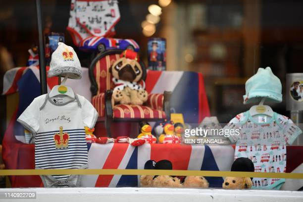 A Royal Baby outfit is pictured on display in a shop window as excitement builds in the town waiting for the birth of the child of Britain's Prince...