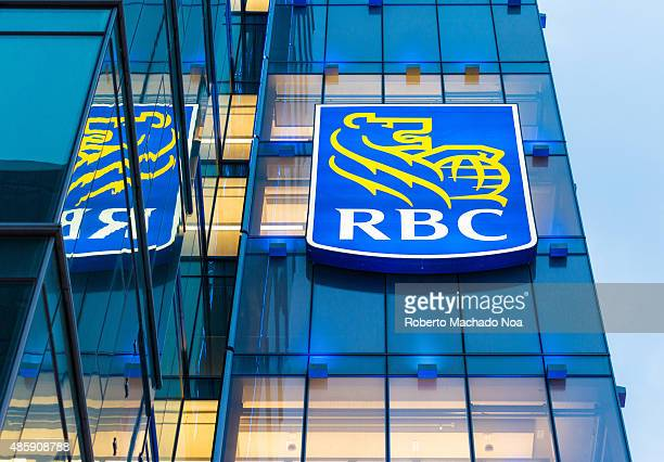 WEST TORONTO ONTARIO CANADA Royal Bank of Canada signage on a glass facade building The signage has the outline of a lion holding a globe in yellow...