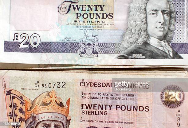 Royal Bank of Scotland Group Plc twenty pound banknote sits above a Clydesdale Bank Plc banknote of the same denomination in this arranged photograph...
