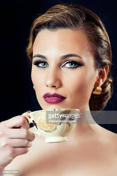 Royal Blonde Woman with Elegant Hairstyle Drink Coffee