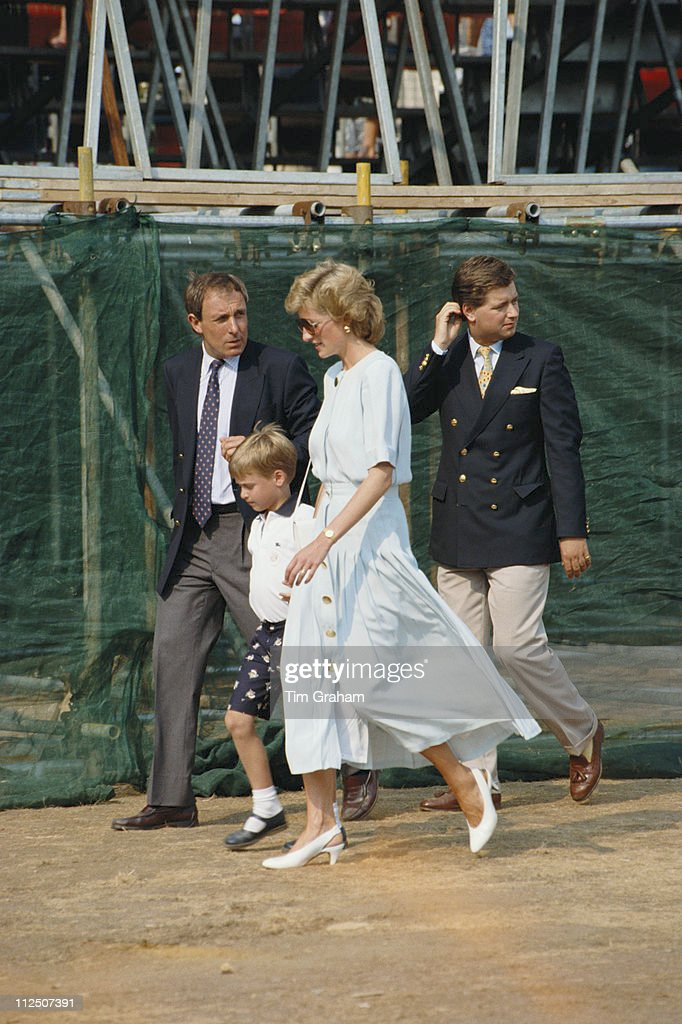 Royal bodyguard Dave Sharp escorts Prince William and his mother, Diana, Princess of Wales (1961-1997), with Michael Fawcett walking behind at the Cartier International Polo Day, held at Smiths Lawn Polo Club in Windsor, Berkshire, England, Great Britain, 23 July 1989. Fawcett is the valet of Prince Charles.